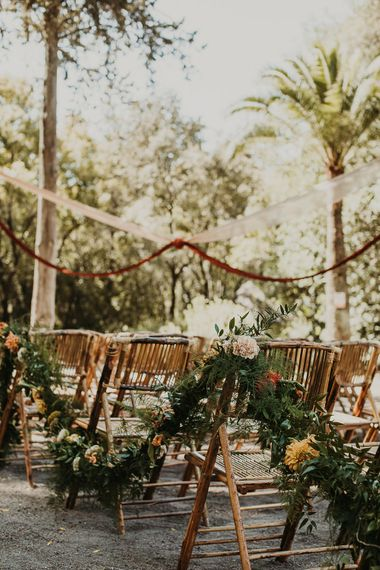 Floral garland decorating the aisle chairs