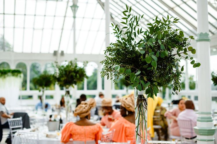 Foliage table centrepieces for a botanical wedding in a glasshouse
