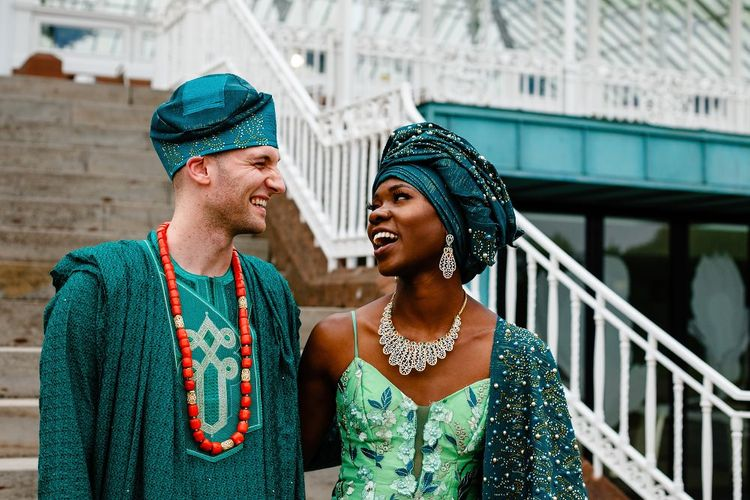 Bride and groom in green Nigerian outfits at Liverpool wedding