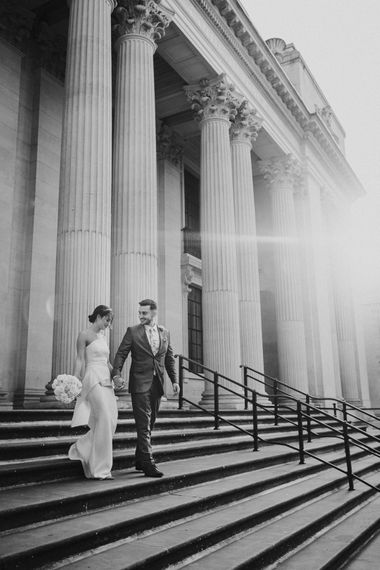 Bride and groom walking down the steps at Old Marylebone Town Hall wedding