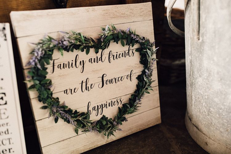 DIY wooden and floral heart wedding sign