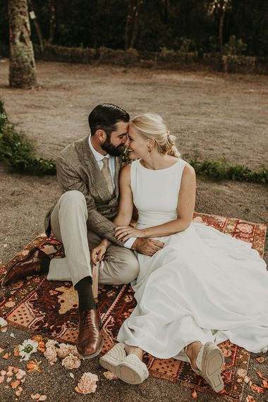 Bride and groom portrait sitting on a Persian rug