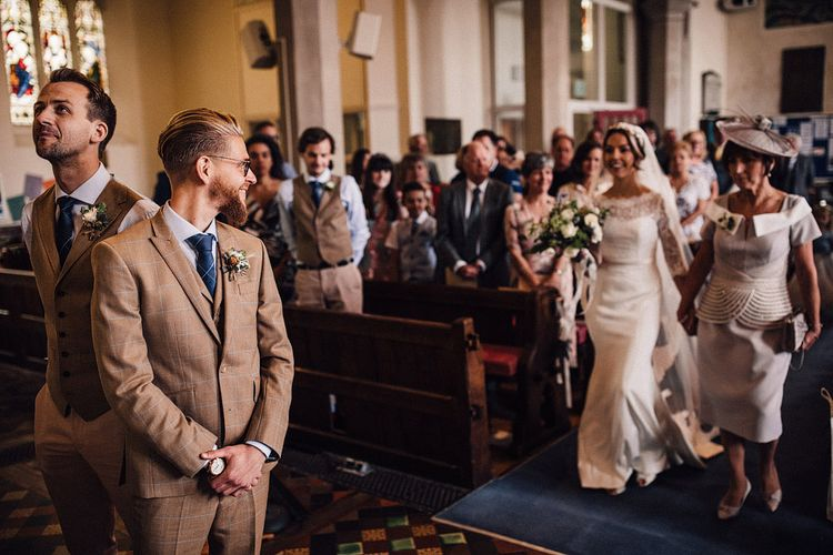 Church wedding ceremony bridal entrance in Sassi Holford wedding dress