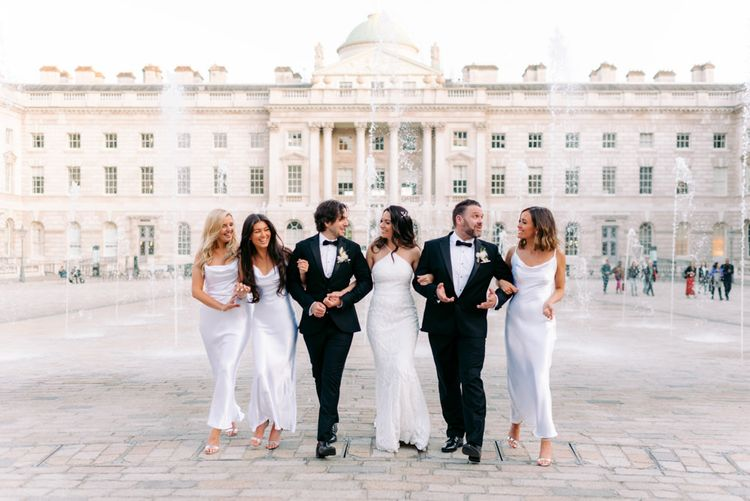Wedding party at Somerset House with water fountains as the backdrop