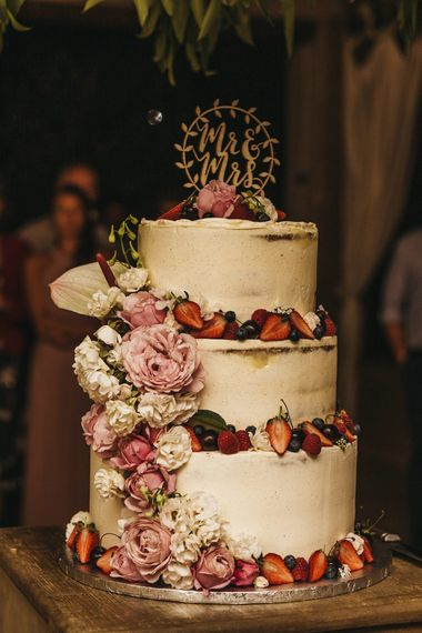 Rustic wedding cake with pink flower decor
