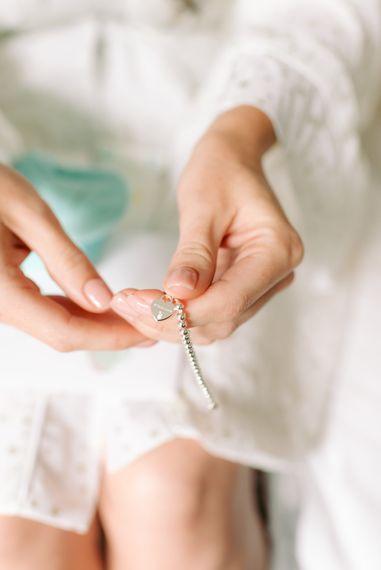 Bride holding personalised wedding bracelet