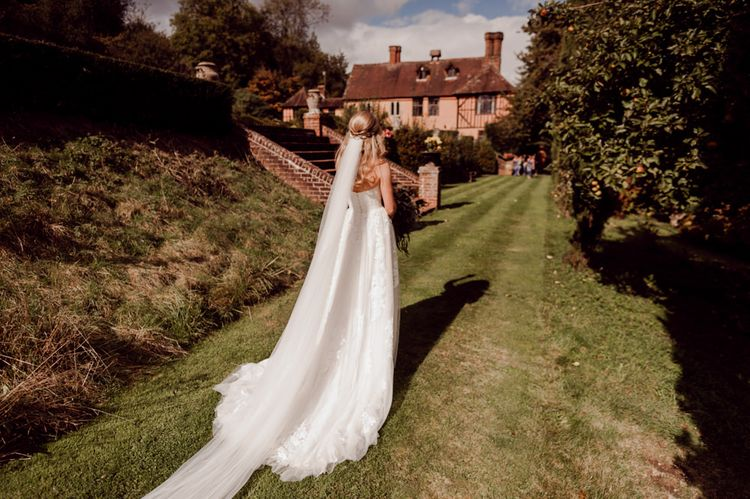 Beautiful bride with veil at Larmer Tree Gardens Wedding