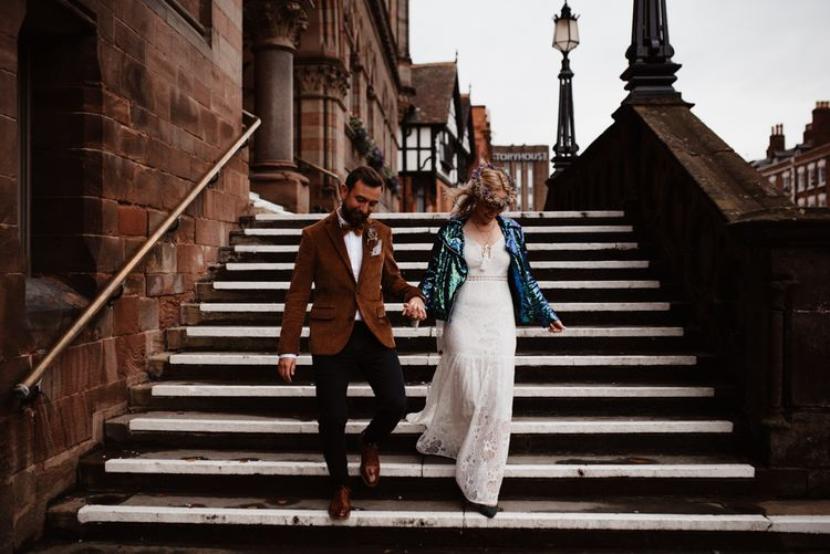 bride and groom walking down the stairs at Chester Town Hall
