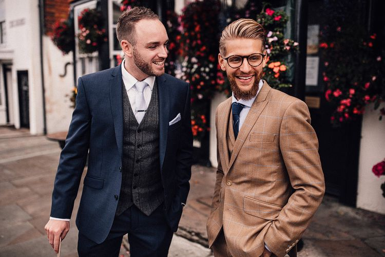 Groom in brown check suit and best man on the wedding morning