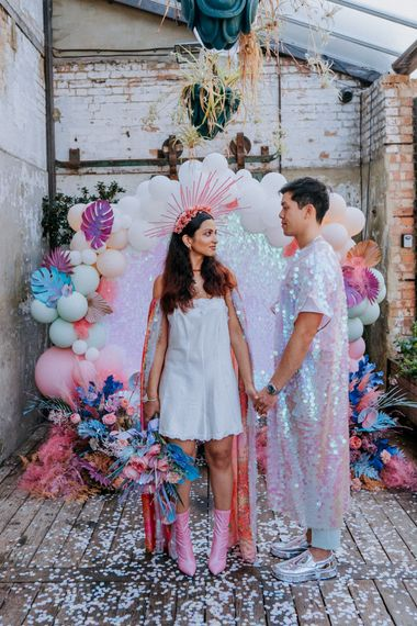 Bride and groom at holographic pastel festival inspiration