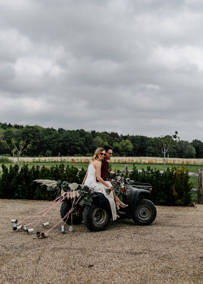 Micro wedding with bride and groom riding a quad bike