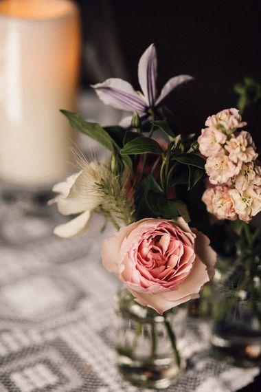 Pink rose wedding flowers at rustic wedding
