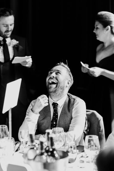 Groom laughing during wedding speech at Titanic Hotel Liverpool