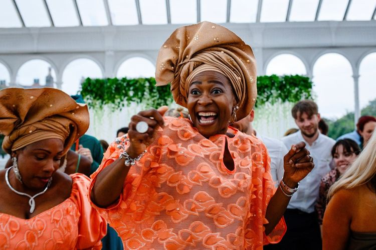 Wedding guests in Coral Nigerian Outfits