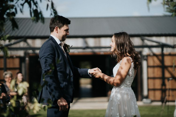 Bride and groom exchanging vows at outdoor humanist ceremony at Willow Marsh Farm