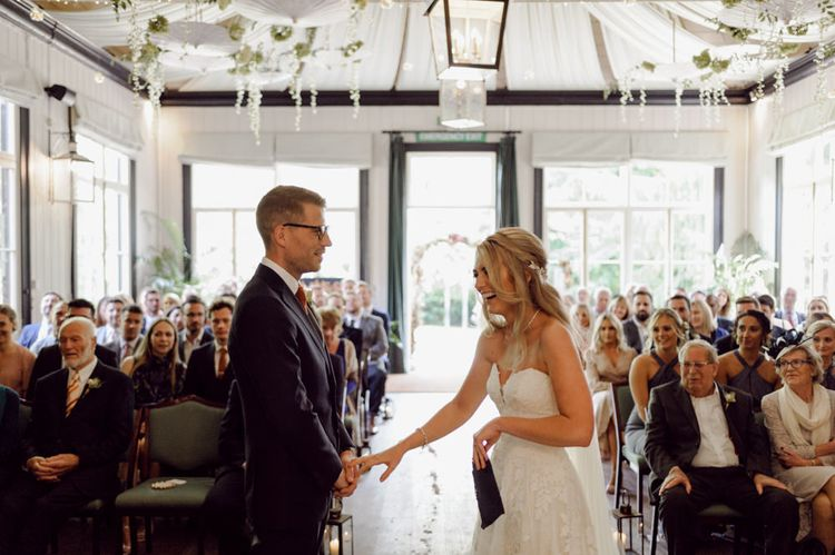 Bride greets groom at the altar