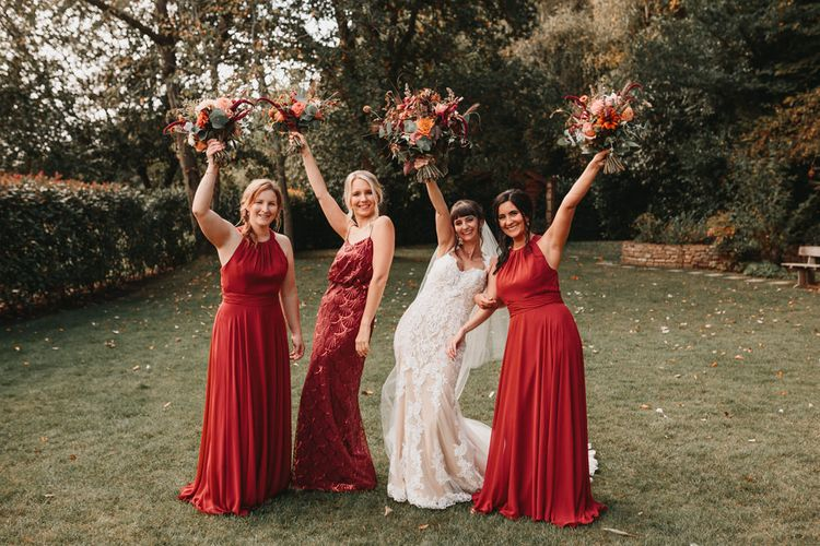 Bridesmaids in burgundy dresses at Millbridge Court wedding