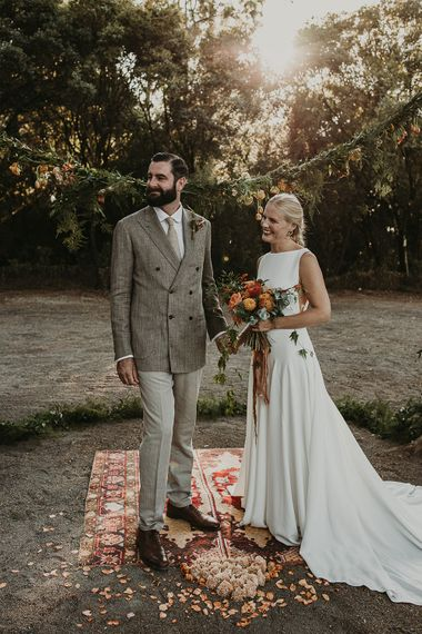 Bride and groom at the altar of outdoor Andalusia wedding