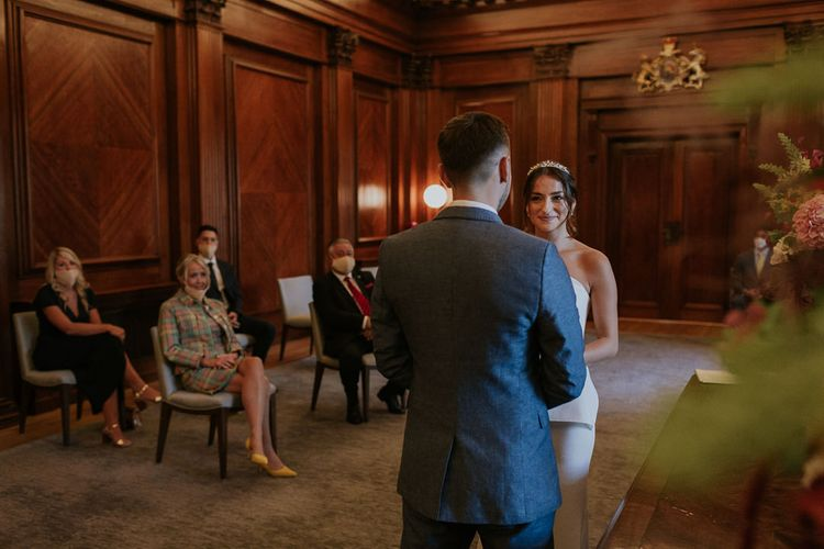 Bride and groom exchanging vows at Old Marylebone Town Hall wedding