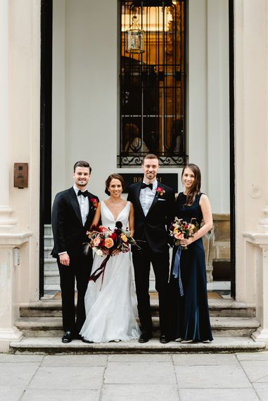 Bride and groom with best man and bridesmaid at Carlton House Terrace wedding