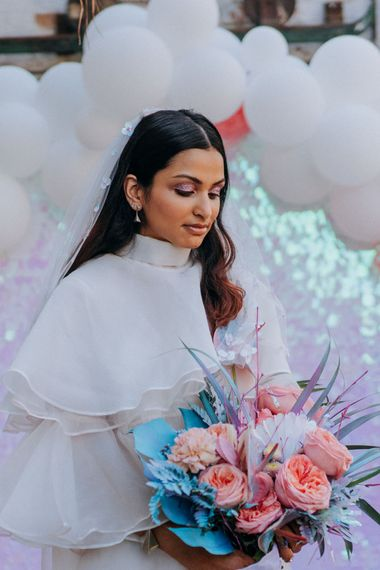 Bride holding her holographic pastel wedding bouquet