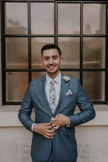 Groom in grey suit at micro wedding