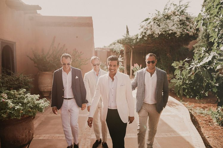 Groomsmen in trousers, open button shirts and jackets for Marrakech wedding