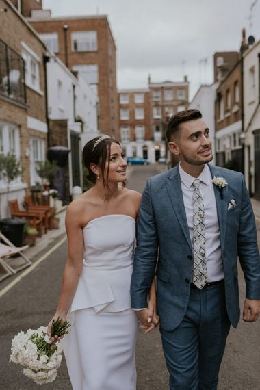 Bride in strapless Roland Mouret dress at intimate London wedding