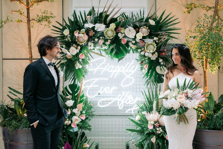 Happily ever after neon sign for tropical themed wedding