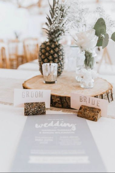 DIY wedding centrepieces on wood slice and with pineapple