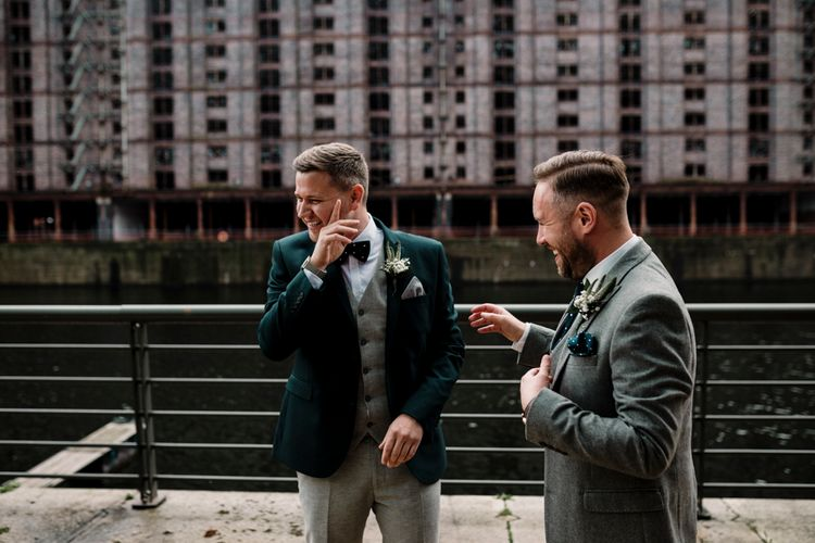 Grooms in grey and teal green suits for contemporary wedding at Titanic Hotel Liverpool