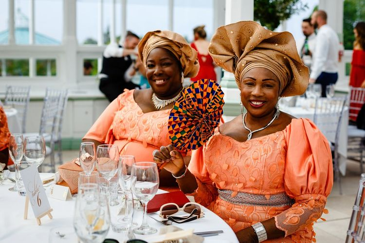 Wedding guests in traditional Nigerian outfits