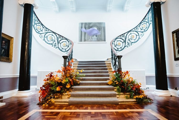 Staircase floral arrangements at Carlton House Terrace wedding