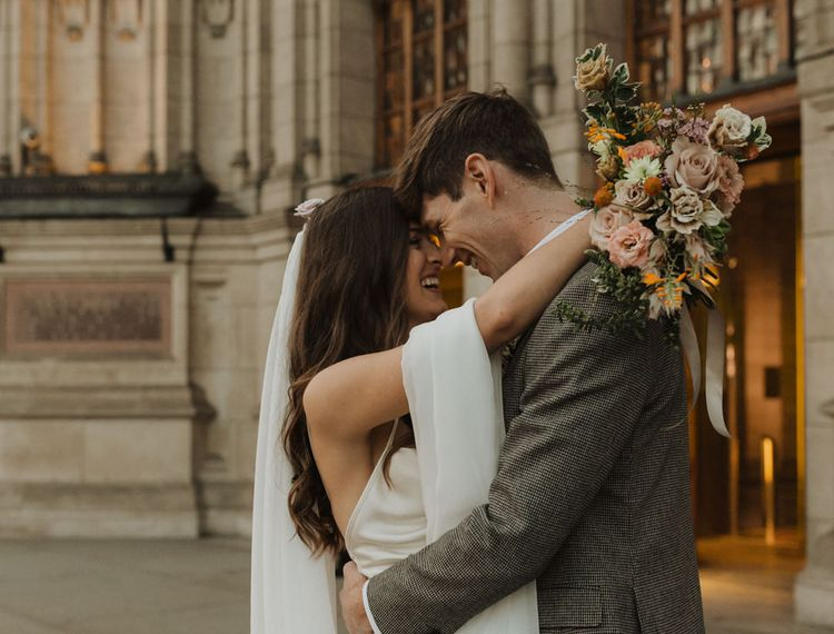Bride and groom portrait outside their Holy Trinity Brompton Church micro wedding