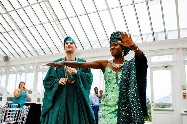 Bride and groom money dance entrance in green Nigerian outfits