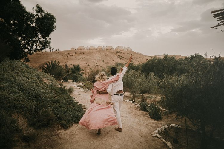 Bride and groom at Marrakech wedding with bride in pink dress