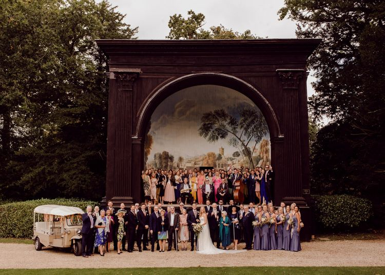 Guests gather outside at Larmer Tree Gardens Wedding