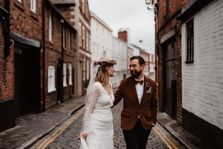 Boho bride and groom portraits in cobbled street by Taylor-Hughes Photography
