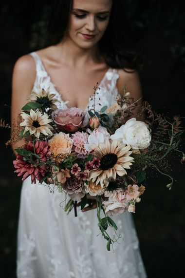 Wedding bouquet with dusky pink, yellow and ivory wedding flowers