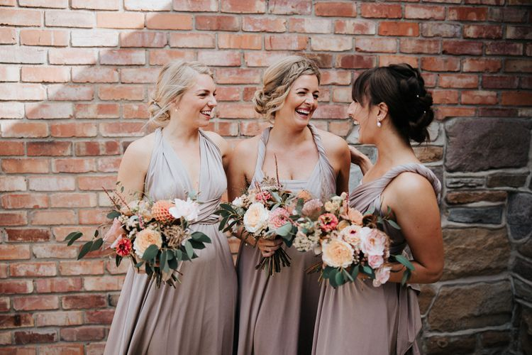 Bridesmaids in dusky pink bridesmaid dresses