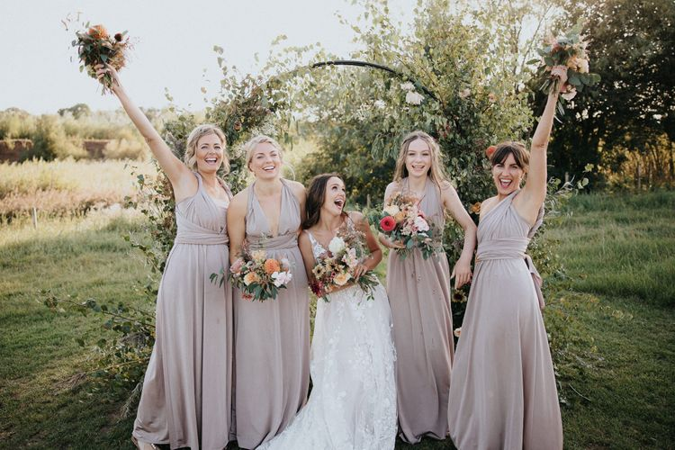 fun bridal party portraits with bridesmaids in dusky pink dresses
