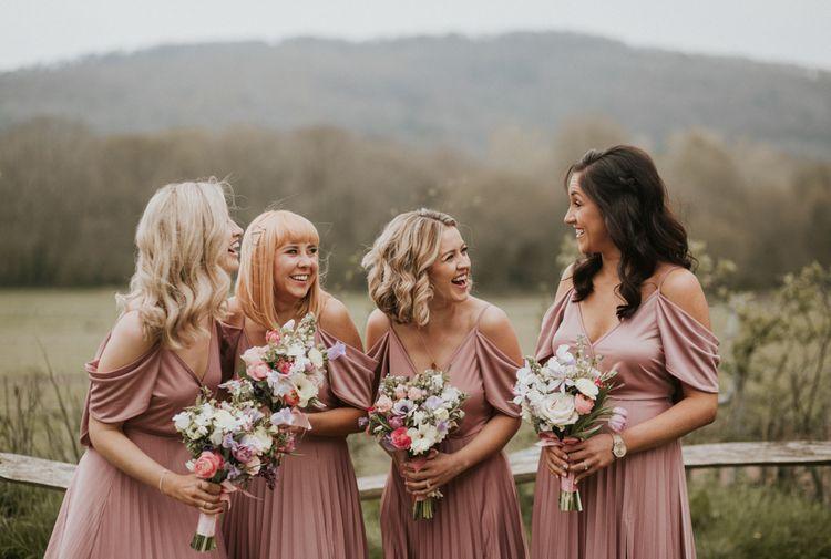 bridesmaids in dusky pink dresses