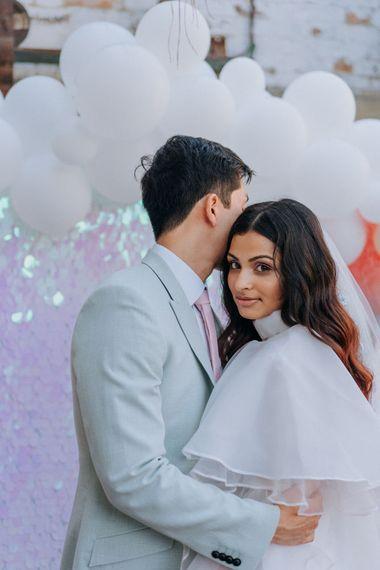 Bride in ruffle wedding dress
