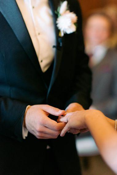 Exchange of wedding rings photo shot by Nkima Photography