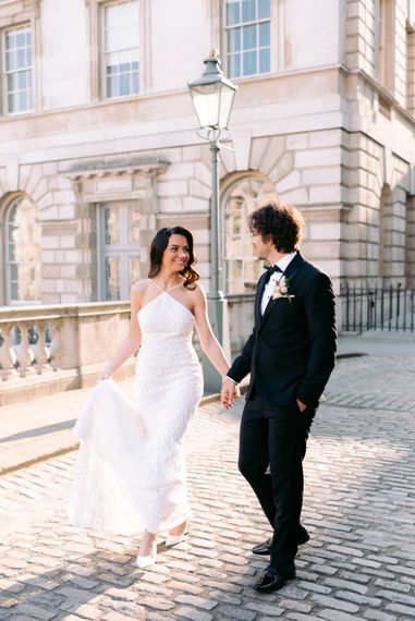 Bride and groom at London wedding with halter neck wedding dress
