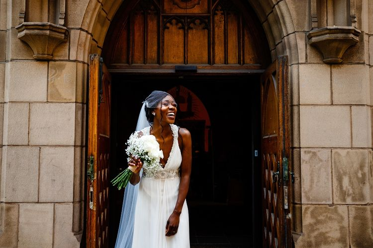 Beautiful bride in a Jenny Packham wedding dress with birdcage veil
