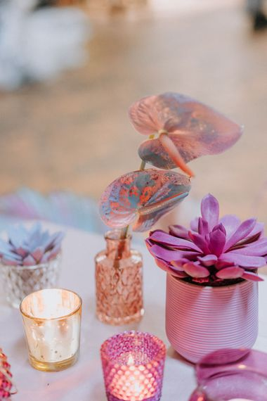 Spray painted cactus and anthuriums in vases