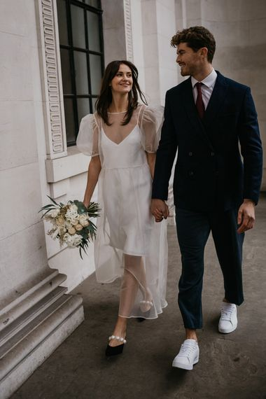 Stylish bride and groom outfits for intimate wedding ceremony