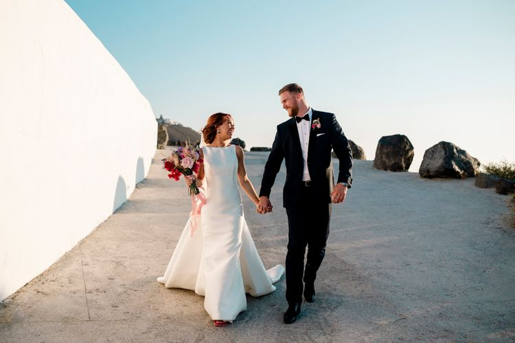 Bride in Pronovias wedding dress and groom in tuxedo at Santorini wedding