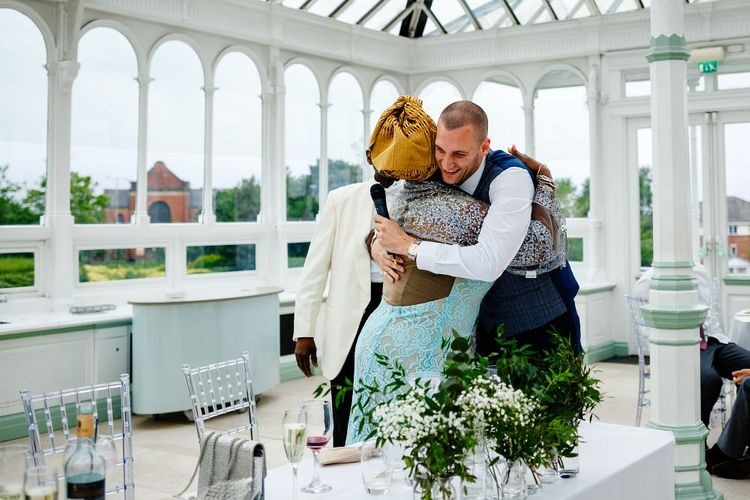 Groom hugging his new mother in law